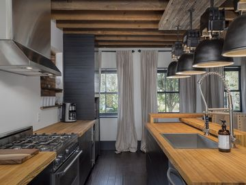 """The Soho' Loft... Industrial Chic in East Aurora Village!"