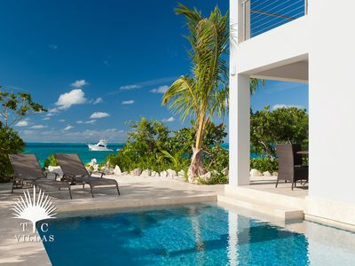 Photo for Water Edge Villa on Grace Bay Beach, a romantic escape to Turks and Caicos