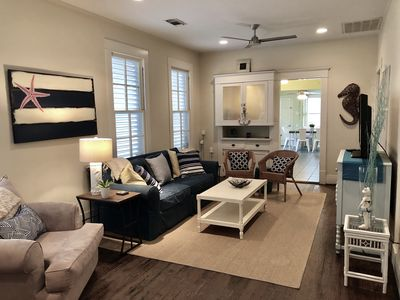 Bright and spacious living room. Pull Out couch, flat screen TV w/ DVR & DVD