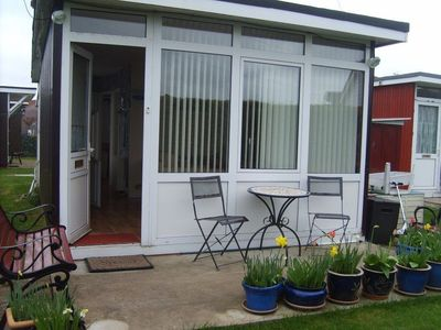 Photo for Quiet Park, South Facing Chalet. Short (7mins) Walk to Village, Beach & Prom