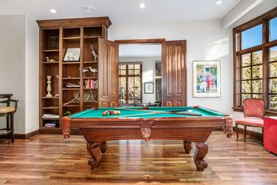 Challenge your friends and family to a game on the billiard table.