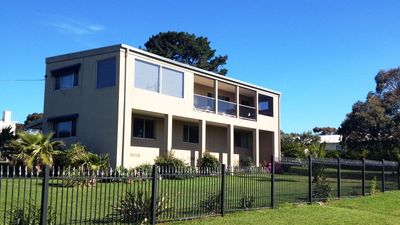 Stones throw from beach! Set on large, quiet, fenced block.