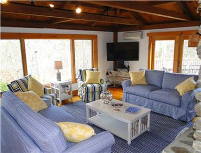 Living Large lofted living room with flatscreen TV, newly furnished