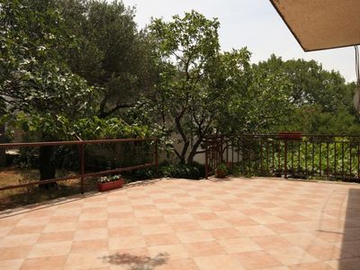 Photo for Four bedroom apartment with terrace Starigrad (Paklenica)