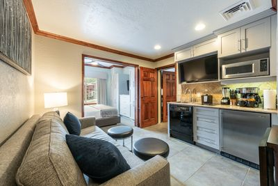 Living room, kitchenette and a king size master bedroom