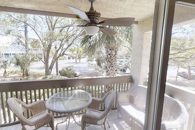Relax on the porch which overlooks the South Beach Inn, Shops, Restaurants and Salty Dog.