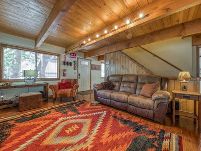 Photo for Modernized cabin w/ a full kitchen, gas fireplaces, & furnished deck
