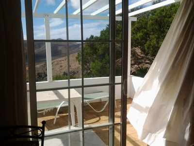 Photo for Villa EDENITA B in Uga for 2 persons with shared pool, terrace, garden, views to the ocean, views of the volcanoes, WIFI on the go and less than 4000m to the sea