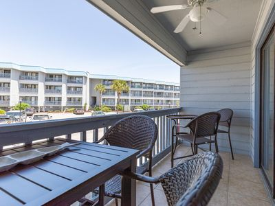 Balcony overlooking the Pool w/ partial Bay Views
