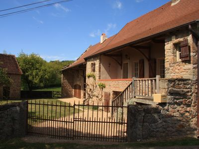 Photo for Attractive converted farmhouse with secluded pool in rural setting