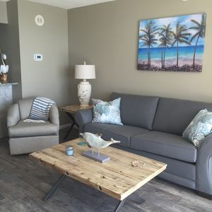 living area with queen sleeper sofa for 2