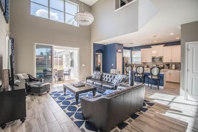 The two-story living area offers plenty of space to relax and unwind.