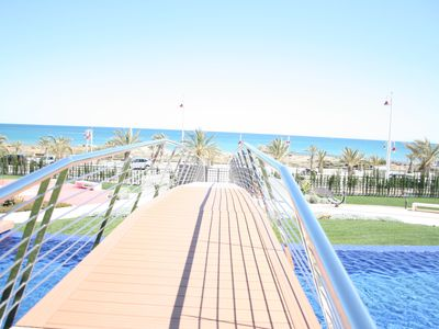 Photo for OCEAN VIEW luxury apartment direct access to the beach