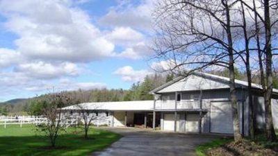 Barn Apartment with small deck.  Please Park in front of the large bay garage