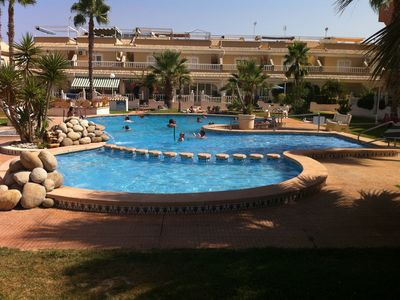 Photo for Spacious 3 bedroom townhouse, communal pool, close to beach and golf