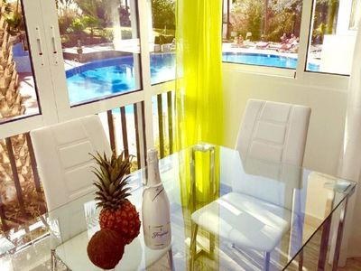Photo for 103.Enchanting pool view, wifi free and sea front