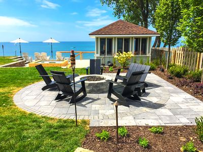 Luxury lakefront house with hot tub, fire pit, assn. beach, stunning view!