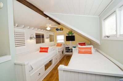 The Sleeping Loft is a huge hit with kids of all ages and is a completely customized with 4 built in galley style twin beds with drawers and cubby's for storage.  Also in Kid Land there is a 32' Flat Screen/DVD Combo TV.