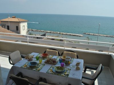 Photo for CASA NINA Elegant apartment facing the sea, a few meters from the beach