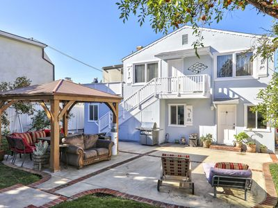 Photo for Best location! 1 blocks from the Beach, walkway to just about anywhere, secluded