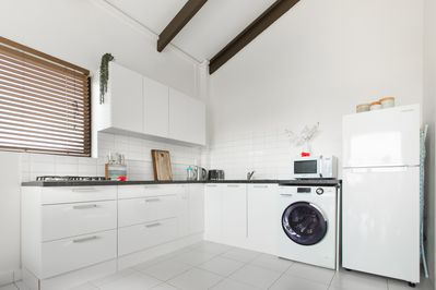 Self-contained kitchen with gas-hob, fridge/freezer, microwave, washer and more.
