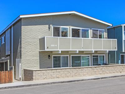 Photo for Upper Beach Condo! Ocean views, balcony, BBQ, just 1 House from Sand!