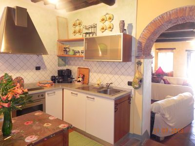 Kitchen separated by an arch from the living area.