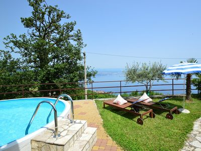 Photo for This 5-bedroom villa for up to 11 guests is located in Lovran and has a private swimming pool, air-c