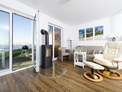 Photo for Modern holiday home in direct water location - Ideally located - Only a few meters from the Weidefelder sandy beach and harbor promenade - Equipped with sauna, whirlpool and fireplace
