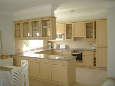 Large, Modern, open-plan fully fitted Kitchen.