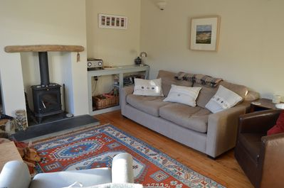 The living room with cosy log burner