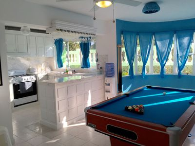 Play pool right next to the pool!