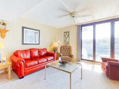 Photo for Comfortable condo w/ balcony, shared pool, hot tub & more - walk to the beach!