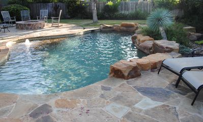 River-like pool with , firepit and plenty of space to float and lounge.