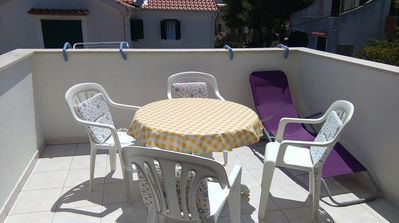 Photo for Two bedroom apartment with terrace and sea view Rukavac, Vis (A-13337-b)