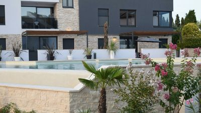 Photo for 5 star apartment in a newly built exclusive complex directly on the sea with pool