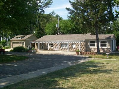 Beautiful Lakefront stone cottage with sandy walkoout beach with greatl sunsets