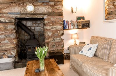 Fireplace and bookshelf with games