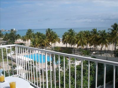 View From Balcony of pool, grove of palm trees and Atlantic ocean! Simply heaven