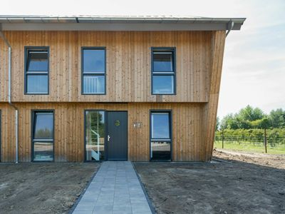 Photo for Semi-detached house in Vrouwenpolder, 800m  from the beach