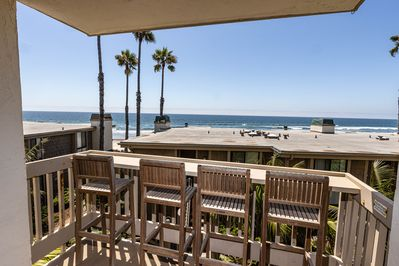 Panoramic ocean views are yours to enjoy from the living room balcony.