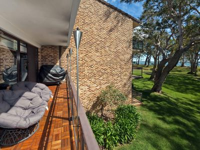Photo for A first floor unit with views across parklands to Little Beach.