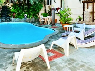 Photo for Homerez last minute deal - Spacious apt with shared pool