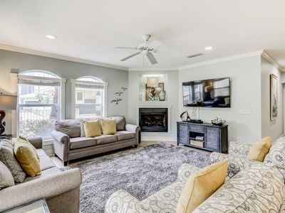Photo for Coastal chic condo steps from the sand w/ shared pool & central location!