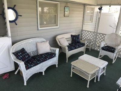 Enjoy coffee on this screened in porch and hear the ocean and smell the salt air