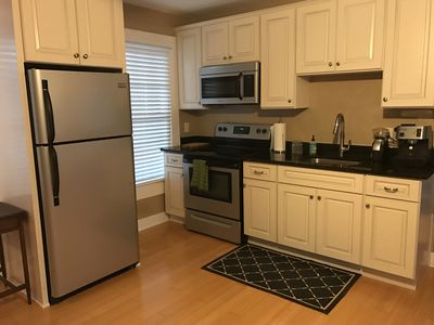 spacious kitchen with full sized appliances and espresso maker