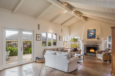 ~  - Spacious comfortable living room with a wood burning fireplace.