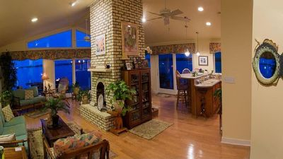 Three sided fireplace in great room.  View from entrance. Sofa & love seat...