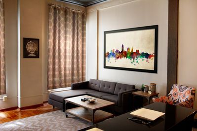 Living Room with modern couch, coffee table and 55' HD Smart TV
