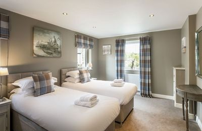 Ground floor:  Bedroom with 6' super king bed that can be configured as twin beds on request